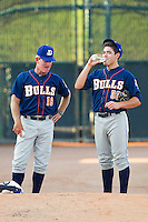 Durham Bulls pitching coach Neil Allen #16 chats with starting pitcher Matt Moore #33 prior to the game against the Charlotte Knights at Knights Stadium on August 2, 2011 in Fort Mill, South Carolina.  The Bulls defeated the Knights 18-3.   (Brian Westerholt / Four Seam Images)