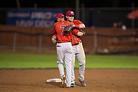 Orem Owlz infielders Livan Soto (7) and Justin Jones (33) celebrate a victory after a Pioneer League game against the Helena Brewers at Kindrick Legion Field on August 21, 2018 in Helena, Montana. The Orem Owlz defeated the Helena Brewers by a score of 6-0. (Zachary Lucy/Four Seam Images)