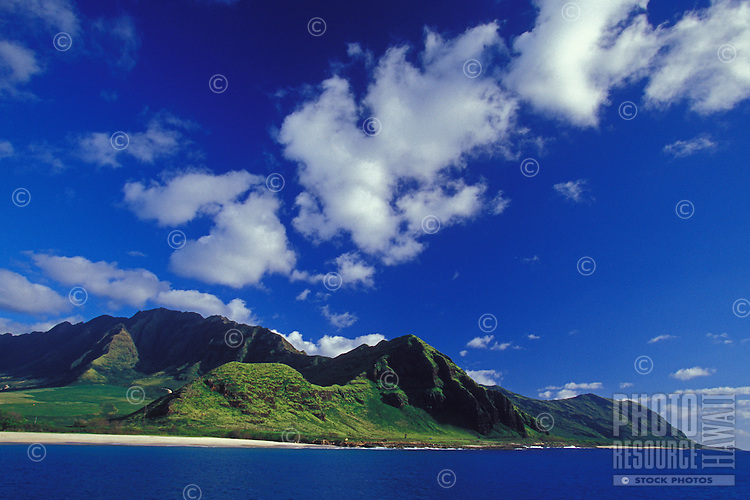 Waianae mountains as seen from the ocean on a beautiful sunny Hawaiian day