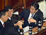 December 24, 2014, Tokyo, Japan - Prime Minister Shinzo Abe, right, talks to his fellow Democrats before the start of a parliamentary process to elect Japan's new leader during a special Diet session convened in Tokyo on Wednesday, December 24, 2014. Abe was re-elected as prime minister and set to form a new Cabinet. (Photo by Natsuki Sakai/AFLO)