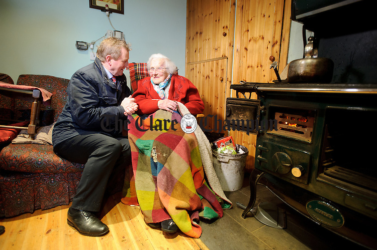 Enda Kenny, Taoiseach sits and chats with Ann Gibson in her home at Kilbaha during his visit to Loop Head to launch the Fine Gael tourism initiative. Photograph by John Kelly.