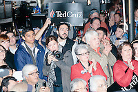 People listen as Texas senator and Republican presidential candidate Ted Cruz speaks at The Village Trestle restaurant in Goffstown, New Hampshire, on Wed., Feb. 3, 2016. In the crowd, Boston Herald photographer Angela Rowlings is visible.