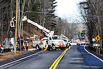 TORRINGTON, CT, 17 DEC 30- 123013AJ01- Workers from AT&T replace phone lines along Winsted Road in Torrington Monday afternoon. A one-car crash Monday morning severed an old utility pole that was replaced. The work took about 12 hours.  Alec Johnson/ Republican-American