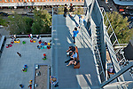 Looking down at the colorful chairs on one of the terraces of the Whitney Museum of American Art, that sits right by the Hudson River and the beginning of the Highline (elevated park on an old rainway line)