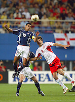 Claudio Reyna goes up for a header. The USA lost 3-1 against Poland in the FIFA World Cup 2002 in Korea on June 14, 2002.