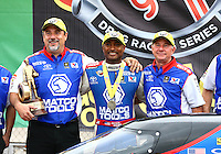 Apr 27, 2014; Baytown, TX, USA; NHRA top fuel dragster driver Antron Brown celebrates with crew chief after winning the Spring Nationals at Royal Purple Raceway. Mandatory Credit: Mark J. Rebilas-