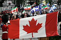 "Quebec City, July 1, 2007 ? Protesters take part into the annual MLNQ (Mouvement de liberation National du QuÈbec) Canada Day protest while Conservative Minister JosÈe Verner proceed with the raising of the flag ceremony in front of the Quebec City hall July 1, 2007. Each year, the MLNQ gather a couple of dozens of hard line separatists to protest the ""Canadian colonialism demonstration of Canada Day"".<br /> <br /> PHOTO :  Francis Vachon - Agence Quebec Presse"