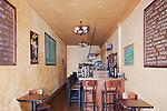 Wine Bar in Wine Shop, mirror background, warm tones, open bottle.