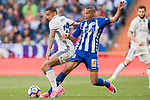 Danilo Luiz Da Silva (l) of Real Madrid fights for the ball with Deyverson Brum Silva Acosta of Deportivo Alaves during their La Liga match between Real Madrid and Deportivo Alaves at the Santiago Bernabeu Stadium on 02 April 2017 in Madrid, Spain. Photo by Diego Gonzalez Souto / Power Sport Images