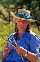 Retired woman with her paintbrushes. Portrait.