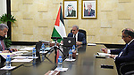 Palestinian Prime Minister Mohammad Ishtayeh, chairs the weekly meeting of his government, via a video link in the West Bank city of Ramallah on April 5, 2021. Shtayyeh reiterated today the Palestinian position in support of neighboring Jordan against any attempt to destabilize it, stressing that stability in Jordan is in the highest Palestinian interest. Photo by Prime Minister Office
