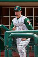 Fort Wayne TinCaps manager Anthony Contreras (10) in the dugout during a game against the Wisconsin Timber Rattlers on May 10, 2017 at Parkview Field in Fort Wayne, Indiana.  Fort Wayne defeated Wisconsin 3-2.  (Mike Janes/Four Seam Images)