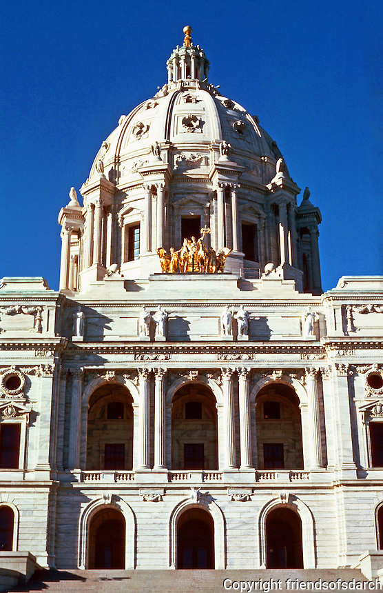 "St. Paul:  State Capitol 1893-1894--dome.  Capitol designed by Cass Gilbert.  Gold-leafed copper and steel quadriga  ""Progress of the State"" by Sculptor Daniel Chester French and Edward Potter, 1905.  Photo '85."