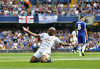 Andre Ayew of Swansea celebrates scoring his sides first goal   during the Barclays Premier League match between  Chelsea and Swansea  played at Stamford Bridge, London