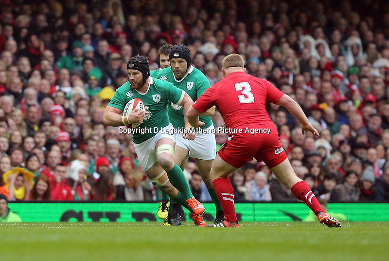 Pictured: Sean O'Brien of Ireland (L) about to be tackled by Lee Samson of Wales (R) Saturday 14 March 2015<br /> Re: RBS Six Nations, Wales v Ireland at the Millennium Stadium, Cardiff, south Wales, UK.