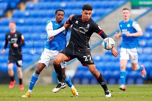 1st May 2021; Weston Homes Stadium, Peterborough, Cambridgeshire, England; English Football League One Football, Peterborough United versus Lincoln City; Morgan Rogers of Lincoln City holds off Reece Brown of Peterborough United