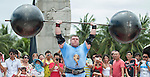 HAINAN ISLAND, CHINA - AUGUST 24:  Vytautas Lalas of Lithuania competes at the Circus Medley event during the World's Strongest Man competition at Yalong Bay Cultural Square on August 24, 2013 in Hainan Island, China.  Photo by Victor Fraile