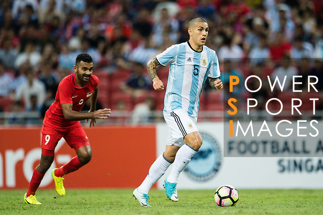 Leandro Paredes of Argentina (R) in action against Faritz Hameed of Singapore (L) during the International Test match between Argentina and Singapore at National Stadium on June 13, 2017 in Singapore. Photo by Marcio Rodrigo Machado / Power Sport Images
