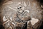 Man in Harley Davidson hat, Grafitti wall