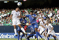 Brian Ching (11) heads a corner toward the Honduran goal as Melvin Valladares (18) defends.  The US Men's National Team defeated Honduras 2-0 in the semifinals of the Gold Cup at Soldier Field in Chicago, IL on July 23, 2009.