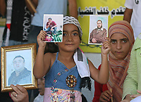 A Palestinian girl  attends a protest calling for the release of Palestinian prisoners from Israel jails, in Gaza August 20, 2007. photo by Fady Adwan""