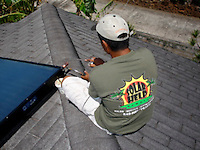 installing solar panels on roof top
