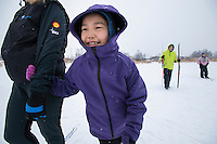 Natalie from Zackar Levi School in Lower Kalskag gets a helping hand from Skiku coach Frankie. Skiku is a non-profit organization with the mission of creating a sustainable Nordic ski program in communities throughout Alaska. Volunteer coaches travel to villages each spring to instruct youngsters and distribute donated equipment with the goal of establishing ski programs at rural schools.  Photo by James R. Evans