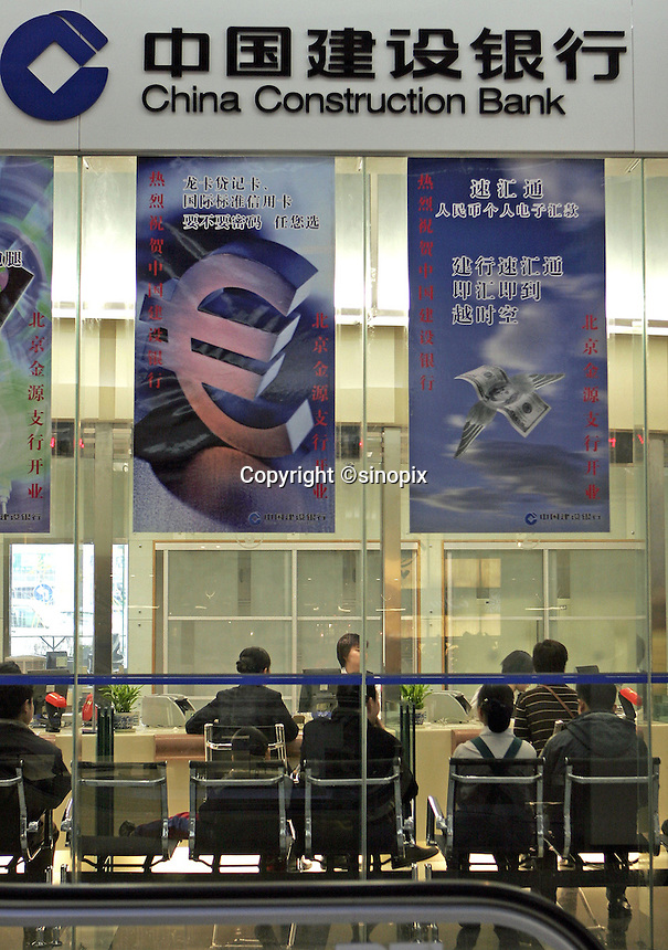 People are served in a branch of China Construction Bank in a Beijing shopping mall, China..