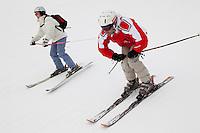 Skiers descend the 'La Duche' ski run, near Le Grand Bornand, France, 14 February 2012.