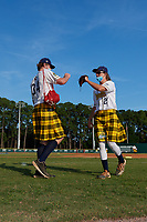 Savannah Bananas Logan Workman (27) fist bumps Eli Ellington (34) before a Coastal Plain League game against the Macon Bacon on July 15, 2020 at Grayson Stadium in Savannah, Georgia.  Savannah wore kilts for their St. Patrick's Day in July promotion.  (Mike Janes/Four Seam Images)