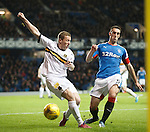 Lee Wallace charges down Scott Brown of Dumbarton