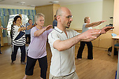 Tai Chi class at sheltered accommodation for the elderly in Marylebone, London.
