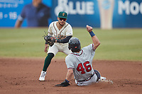 Greensboro Grasshoppers shortstop Francisco Acuna (7) prepares to apply a tag to Garrison Schwartz (46) of the Rome Braves as he attempts to steal second base at First National Bank Field on May 16, 2021 in Greensboro, North Carolina. (Brian Westerholt/Four Seam Images)