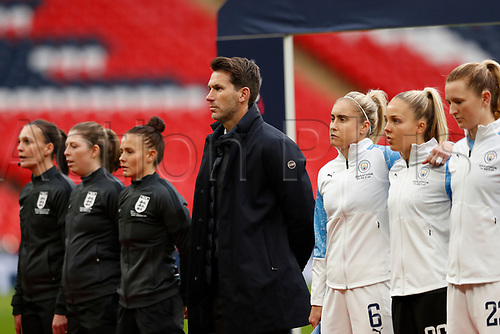 1st November 2020; Wembley Stadium, London, England; Womens FA Cup Final Football, Everton Womens versus Manchester City Womens; Manchester City Women Head Coach Gareth Taylor stands for the national anthem alongside Manchester City Women's starting eleven