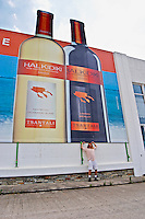 Winery building. David Furer. Huge poster advertising the wine. Tsantali Vineyards & Winery, Halkidiki, Macedonia, Greece.
