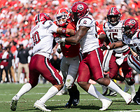 ATHENS, GA - OCTOBER 12: D'Andre Swift #7 of the Georgia Bulldogs is stopped at the goal line by R.J. Roderick #10 and Ernest Jones #53 of the South Carolina Gamecocks during a game between University of South Carolina Gamecocks and University of Georgia Bulldogs at Sanford Stadium on October 12, 2019 in Athens, Georgia.
