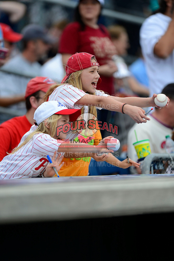 Philadelphia Phillies young fans try to get autographs before a Spring Training game against the Boston Red Sox at Bright House Field on March 24, 2013 in Clearwater, Florida.  Boston defeated Philadelphia 7-6.  (Mike Janes/Four Seam Images)