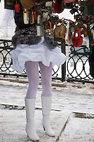 Moscow, Russia, 14/02/2011..A bride hangs a wedding padlock on an artificial tree in temperatures of minus 14C.