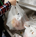WATERBURY CT. - 15 January 2020-011521SV02-Concepcion Ferrer hands out lunch bags to families at Driggs Elementary School in Waterbury Friday. The school gives out about 35 lunches a day.<br /> Steven Valenti Republican-American