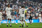 Real Madrid's Raphael Varane (l) and Dani Carvajal (r) have words with referee Santiago Jaime Latre during La Liga match. September 01, 2018. (ALTERPHOTOS/A. Perez Meca)