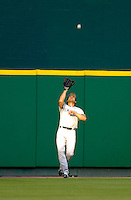 16 June 2006: Johnny Damon, center fielder for the New York Yankees, pulls in a fly ball against the Washington Nationals at RFK Stadium, in Washington, DC. The Yankees defeated the Nationals 7-5 in the first meeting of the two franchises...Mandatory Photo Credit: Ed Wolfstein Photo...