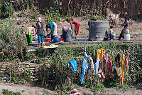 Nepal, Patan.  Women Washing Clothes at a Public Well.