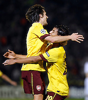 Arsenal player Sebastiane Squillace, right celebrate with Tomas Rosicky, left  during  UEFA Champions league match in group H FC Partizan Belgrade Vs. Arsenal, London, Serbia, Monday, Sept. 28, 2010.  (Srdjan Stevanovic/Starsportphoto.com)