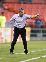 Chicago Fire head coach Frank Klopas yells to his team at RFK Stadium in Washington, DC.  D.C. United defeated the Chicago Fire, 4-2.