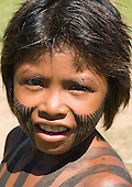 Pará State, Brazil. Aldeia Kokraimoro (Kayapo); boy with black face paint in lines.