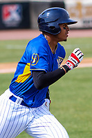 Wisconsin Timber Rattlers shortstop Gilbert Lara (11) runs to first base during a Midwest League game against the Quad Cities River Bandits on April 9, 2017 at Fox Cities Stadium in Appleton, Wisconsin.  Quad Cities defeated Wisconsin 17-11. (Brad Krause/Four Seam Images)