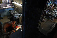 Artisanal gold smiths in Kolkata (Calcutta)....These guys make about 3-400 USD a month at the top end.  They live in the workplace. At night they move the worktables aside and sleep on the floor and there are a few other places for them to crowd in to......BUT... you have to be careful with cultural stigmas.  These guys are all very kind to each other, they are from the same village.  They rotate who goes out for food, for tea.  They take care of each other and they NEED each other.  When one of them goes back to the village, he carries the money from all of them.  When he comes back he brings things to them from all of their families...The goldsmiths are give 102.6 grams of gold and are expected to return 100 grams of jewelry.  The average waste for 100 grams is 1.3 grams.  So the owner of the factory tells them he wants a 20 gram piece of jewelry and they have to figure out how to make it that weight and keep to the design they are given.