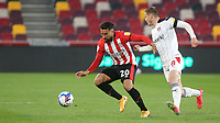 Saman Ghoddos of Brentford shields the ball from Rotherham's Ben Wiles during Brentford vs Rotherham United, Sky Bet EFL Championship Football at the Brentford Community Stadium on 27th April 2021