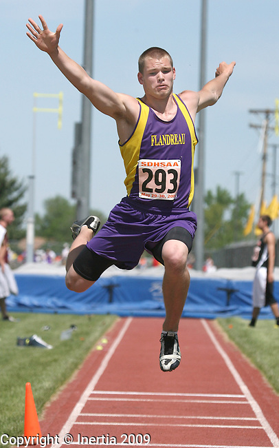 SPEARFISH, SD - May 29: Carter Ahlers of Flandreau leaps during the long jump finals Friday at the Class A State Track Meet in Spearfish. (Photo by Dave Eggen/Inertia)