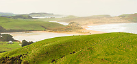 Haldane Bay and farmland at southern most corner of New Zealand Slope Point, Catlins, Southland, New Zealand